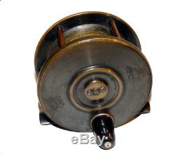 Stunning Hardy 3-1/4 all brass fly fishing reel with Rod in Hand Trade marks